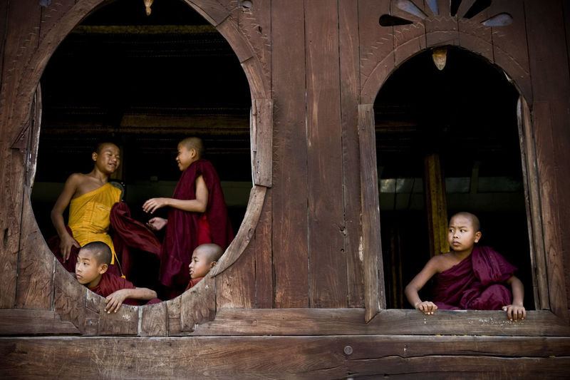 young monks in the young shwe pagoda near Inle lake // burma Architecture Buddhist Temple Building Exterior Built Structure Burma Casual Clothing Check This Out Childhood Day Elementary Age Enjoyment Full Length Fun In Front Of Innocence Leisure Activity Lifestyles Long Hair Monks Myanmar Person The Color Of School Wood - Material Wooden Young Adult