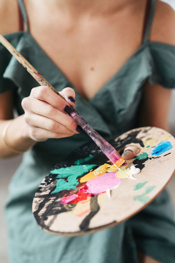 Artist Lifestyle Painter - Artist Painter Holding One Person Art And Craft Midsection Paintbrush Brush Creativity Skill  Front View Indoors  Women Paint Human Hand Craft Palette Multi Colored Occupation Adult Hand Art And Craft Equipment Watercolor Paints