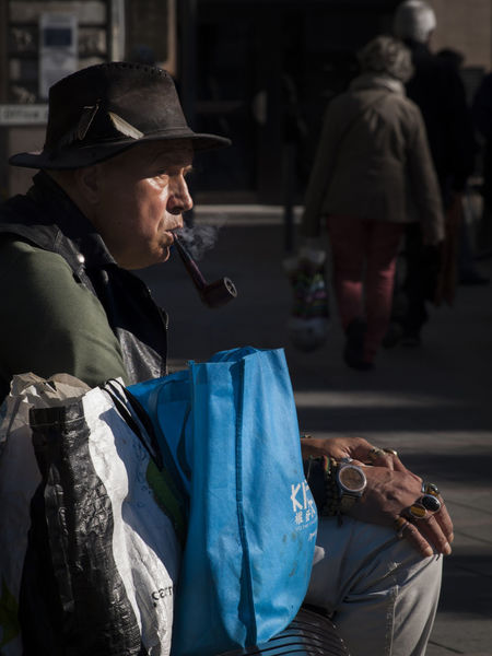 Blue bag man Bag Day Hat Jewelry Men Outdoors Pipe Smoking Real People The Street Photographer - 2017 EyeEm Awards