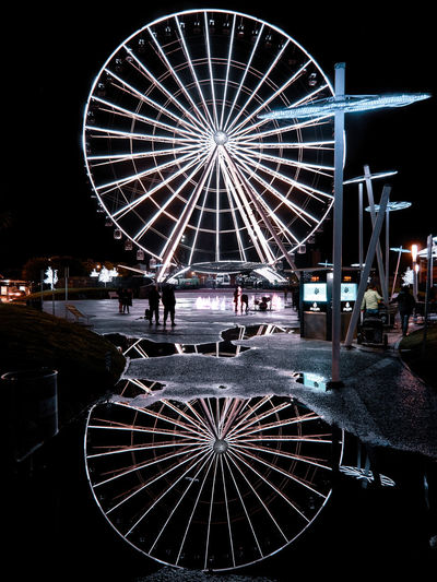 Illuminated ferris wheel at night