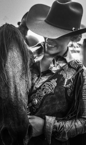 Close-up of smiling young woman with horse