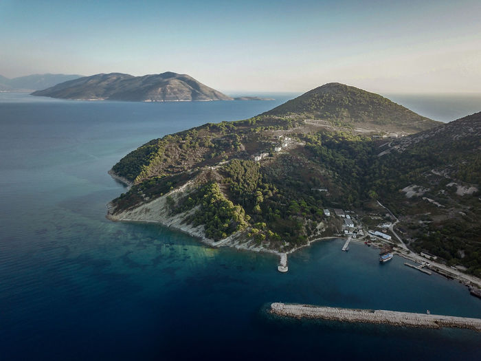 Aerial view of sea and mountains against sky in sazan island