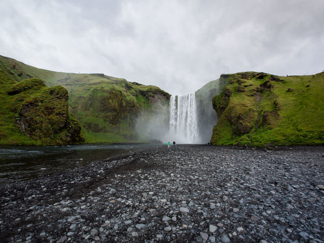 Skogafoss, Iceland, on a cloudy weather Iceland Beauty In Nature Day Long Exposure Motion Mountain Nature No People Outdoors Pebble Power In Nature Rock - Object Scenics Skogafoss Sky Summer Tourism Travel Travel Destinations Tree Water Waterfall Waterfalls