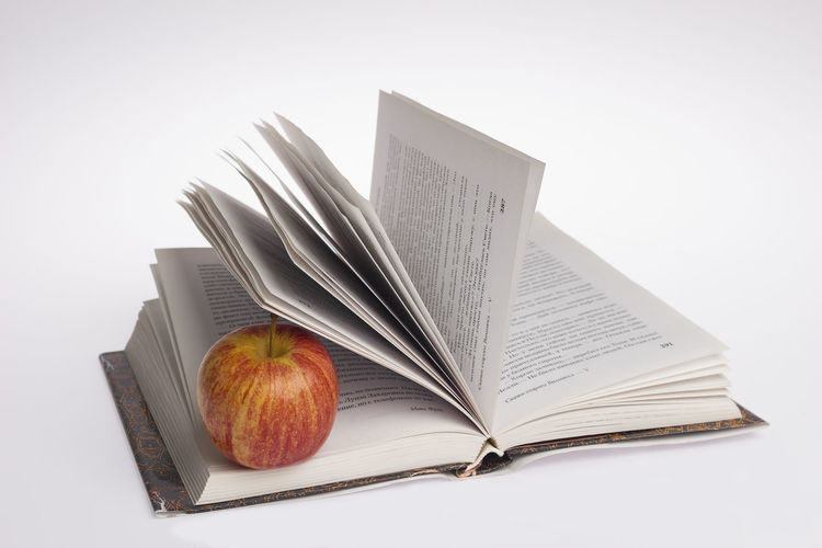 Publication Book Still Life Open Indoors  Paper Studio Shot White Background No People Education Food Close-up Healthy Eating Food And Drink Table Copy Space Fruit Freshness Page Apple - Fruit Old Map