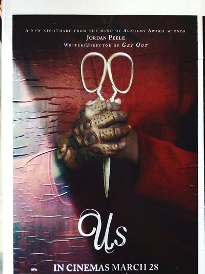 Movies 🎥 Cinema Posters CinemaPosters Kill Murder Killer MOVIE Check This Out Taking Photos Horror Movies 🎥 Us Jordan Peele Poster MOVIE Movie Poster Horror Movies Horror Film Horror Horrormovie Scissors Text Close-up Information Western Script Board Signboard