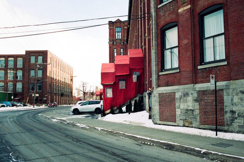 Red car on city street