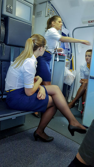 Cabin Crew Conversation Crew Females Indoors  Mode Of Transportation People Public Transportation Real People Ryanair Sitting Stewardess Toghetherness Uniform Vehicle Interior Women Young Women