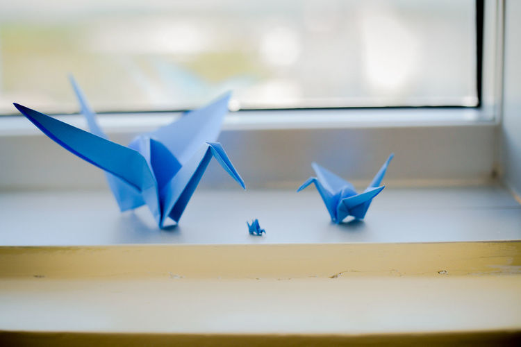 Close-up of paper crafts on window sill