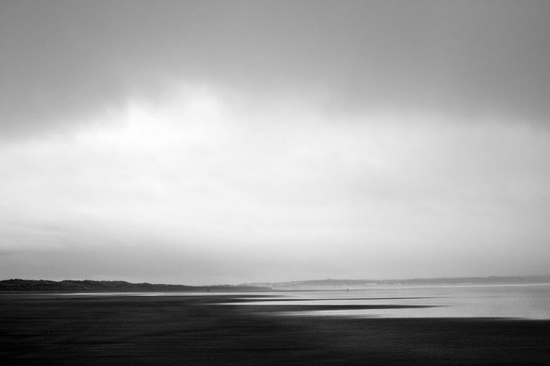 Atmosphere Atmospheric Mood Beach Coastline Distant Horizon Over Land Horizon Over Water Majestic Moody Outdoors Sand Sea Shore Stormy Tranquil Scene Tranquility
