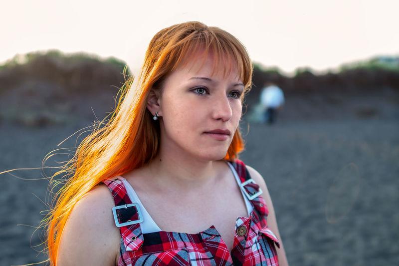 Woman looking away at beach