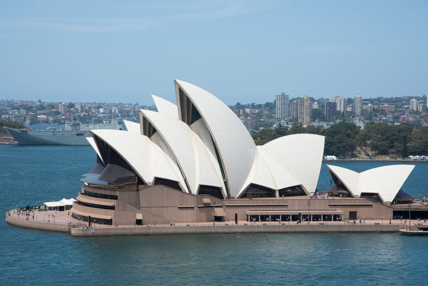 Sydney,NSW,Australia-November 20,2016: Elevated view over the Sydney Opera House at Bennelong Point in Sydney, Australia 20th Century Architecture Australia Cityscape Harbour Roof S Sydney Cove Sydney Opera House Tourist Tourist Attraction  Transportation Venue Arts Culture And Entertainment Bennelong Point Building Exterior Elevated View Expressionist Landmark Military Vessel Nautical Vessel Ship Sydney Travel Destinations Water