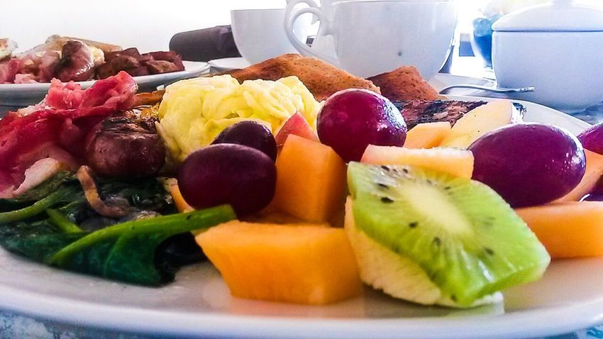 Fruit Food Food And Drink Kiwi - Fruit Variation Indoors  No People Healthy Eating Plate Freshness Close-up Day Sausage Eggs... Breakfast Plate Toasted Bread Mushrooms Spinach Melon Grapes Fruit Salad Kiwi Pineapple Freshness Ready-to-eat