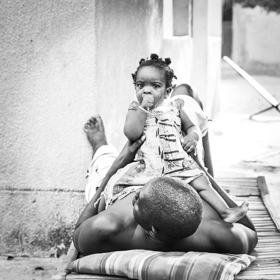 Father and daughter Tears Senegal Baby Childhood Sitting Real People Day Women Full Length Lifestyles Child