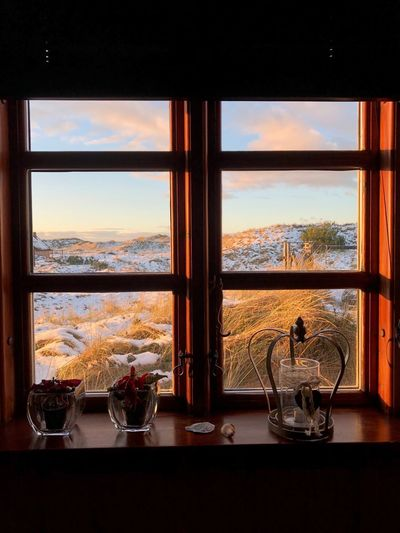 Danish winter view Nature Is Truth Window Indoors  Water Glass - Material Sky Table No People Glass Day Nature Sea Household Equipment Home Interior Refreshment Sunset