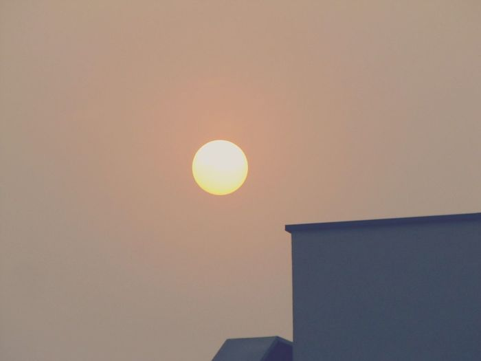 Low angle view of sun against clear sky during sunset