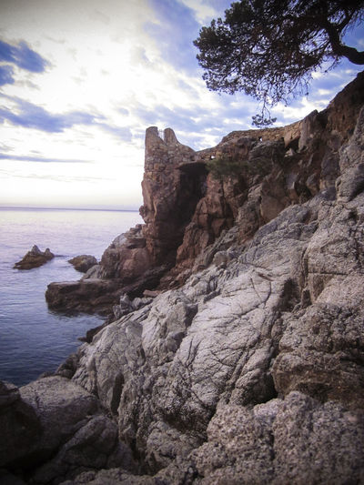 Rocks at Dawn, Lloret de Mar is a Mediterranean coastal town in Catalonia, Spain. One of the most popular holiday resorts on the Costa Brava Lloret De Mar Beauty In Nature Catalonia Cliff Cloud - Sky Day Mediterranean  Mediterranean Seascape Nature Non-urban Scene Outdoors Remote Rock - Object Rock Formation Rocks And Water Scenics Sea Sky SPAIN Tranquil Scene Tranquility Travel Travel Destinations Vivid International Water