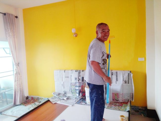 Adults Only One Man Only One Person Only Men Yellow Casual Clothing Adult DIY People Home Improvement Indoors  Home Interior Working Paint Roller Standing Construction Site Day Men Young Adult