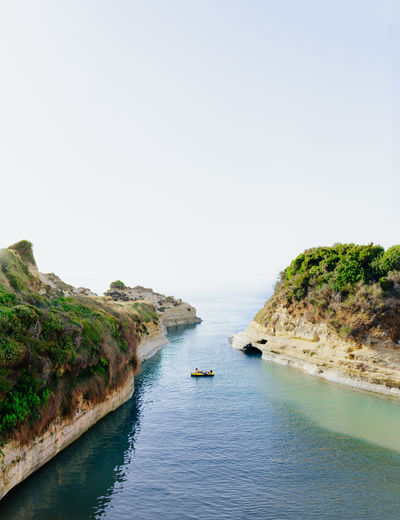 No lines between sea and sky Boat Bushes Canal Canal D'Amour Clear Sky Corfu Day Daylight Dinghy Dry Floating Floating On Water Golden Hour Greece Green Color Hot Day Kerkyra Lookslikefilm Paddle Rocks Rocks And Water Row Sea Sea And Sky Sun