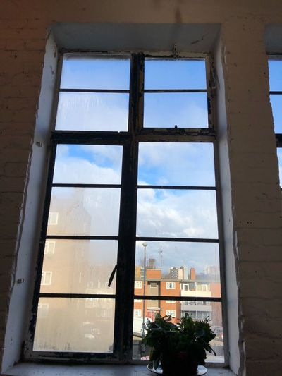 Window frame. Blue sky. Reflection best place for early lunch. Indoors.