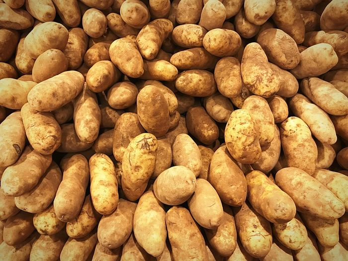 Food And Drink Large Group Of Objects Market Healthy Eating Food Backgrounds Freshness Market Stall Abundance Vegetable For Sale Retail  Full Frame Business Finance And Industry Close-up Consumerism Nut - Food Raw Potato No People Healthy Lifestyle