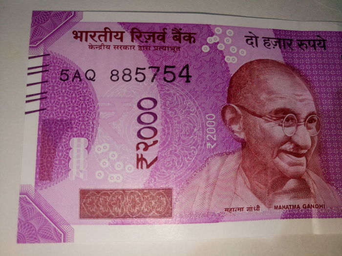 Indian two thousand rupee note 2000 Banknote Business Close-up Currency Indian Finance Finance And Economy Indian Culture  Indian Currency Indian Two Thousand Rupee Note New No People Paper Currency Pink Color Savings Success Text Two Thousand Rupee Note Wealth