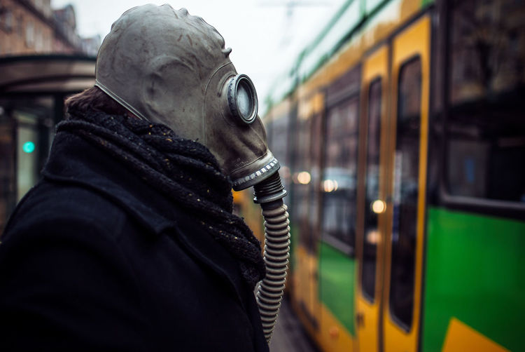 Close-up of man wearing gas mask