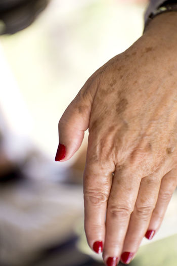 Close-up of cropped hand with nail polish