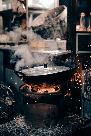 Utennsil on stove in kitchen at restaurant