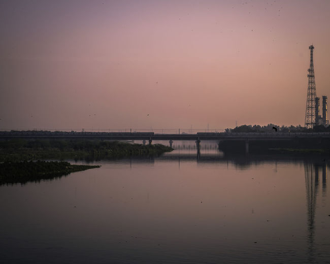 Beautiful Sunset on the banks of Yamuna River in New Delhi. Patiently waiting for the trains to pass by to get the correct shot. #Delhi #EyeEm Nature Lover #EyeEmNewHere #EyeEmReady #India #Nature  #eyembestshot #reflections #sun #sunset EyeEm Gallery Yamuna Beauty In Nature Bestoftheday No People Outdoors Photography River Riverbank Scenics Sky Tranquility Water Waterfront An Eye For Travel
