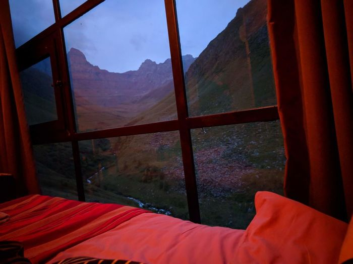 Window Mountain Indoors  Nature Day Bed Mountain Range Beauty In Nature Scenics - Nature No People Transparent Textile Glass - Material Architecture Sky Tree Environment Furniture Landscape