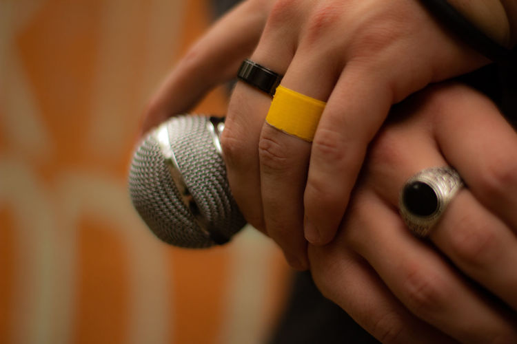 Outdoors Nature One Person One Man Only EyeEm Best Shots Eyeemphotography Hands Human Hand Arts Culture And Entertainment Music Close-up Ring Joint - Body Part Singer  Fashion Show Radio Wrist Rock Group Singing Model Microphone Diamond - Gemstone Platinum Diamond Ring