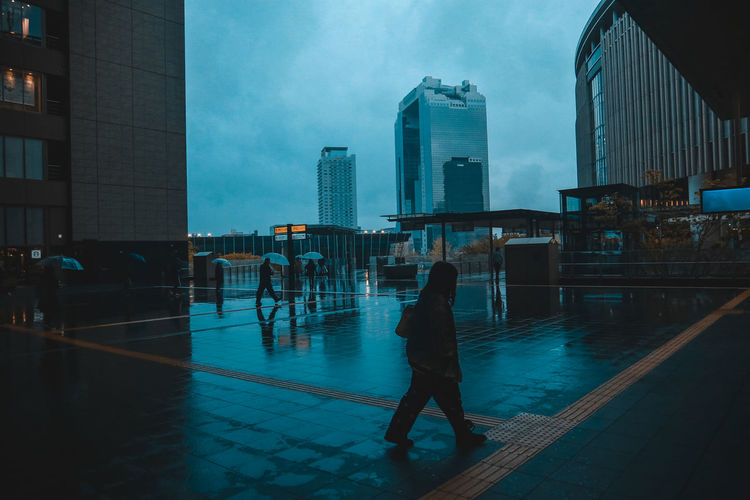 // rainy day // AMPt_community Bad Weather City Dramatic Sky Japan Moody Sky Rain Silhouette Station Strolling Ultimate Japan Walk Weather Blue Cinematography Cloud - Sky Shootermag Streetphotography The Architect - 2018 EyeEm Awards The Photojournalist - 2018 EyeEm Awards