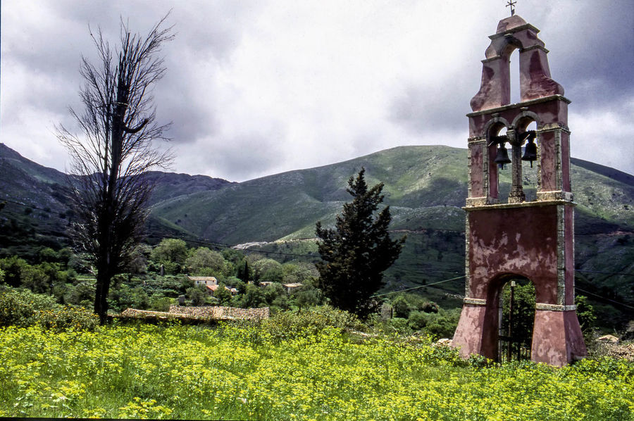 The remains of the Greek Orthodox Church in the deserted village of Perithia, Corfu, Greece Beauty In Nature Bell Tower Cloud - Sky Corfu, Greece History Ionianislands Kerkyra Landscape No People Outdoors Perithia Religion Rural Scene Scenics Spirituality Tranquil Scene Travel Photography