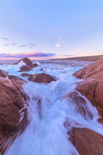 Rushing water at sunset Water Sky Beauty In Nature Tranquility Tranquil Scene Scenics - Nature Nature No People Sea Land Rock - Object Rock Formation Ocean Outdoors Landscape Seascape Sunset Evening Colorful Colors Australia Travel Destinations Travel Flowing Water Flow
