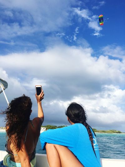 Photography Themes Photographing Sky Cloud - Sky Two People Selfie Smart Phone Wireless Technology Water Portable Information Device Self Portrait Photography Mobile Phone Photo Messaging Blue Technology Outdoors Vacations Togetherness Leisure Activity Adult