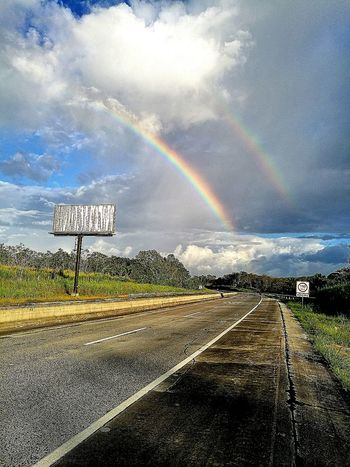 No People Scenics The Way Forward Landscape Beauty In Nature Panama Canal Panama City Panamá Rainbow Rainbow Colors Rainbow Sky Rainbows Rainbow Bridge Road Highway Highways And Byways Cloud - Sky Morning Transportation Highways&Freeways Highways Traveling Home For The Holidays The City Light