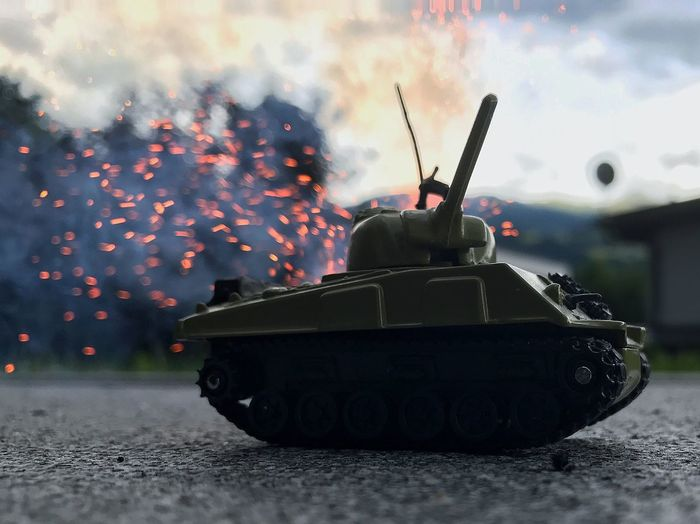 Close-Up Of Armored Tank Toy On Street