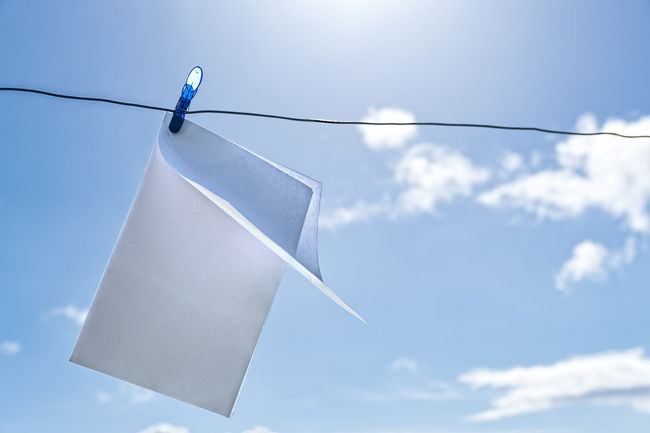 blank sheet Blank Sheet Blue Blue Pin Close-up Clothesline Clothespin Clouds And Sky Day Hanging Low Angle View No People Outdoors Peg Sheet Sky