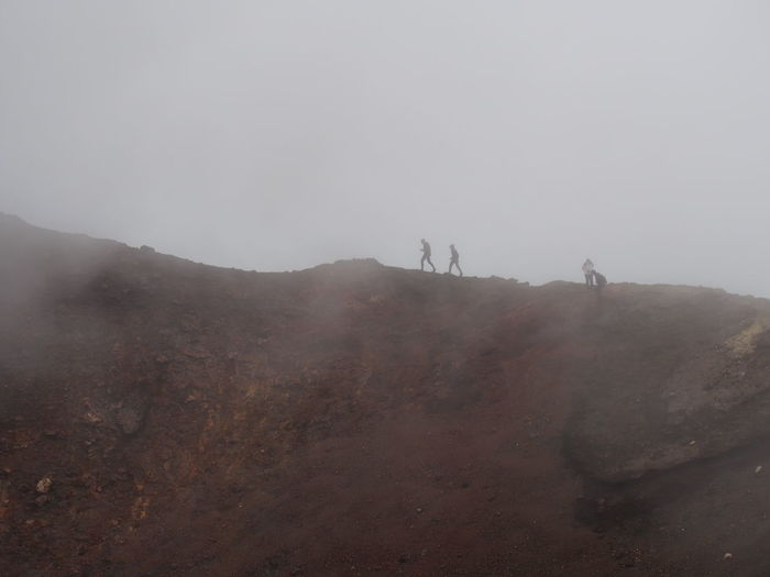 View of people on volcano