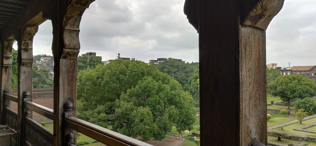 Panoramic view of bridge and trees and buildings against sky