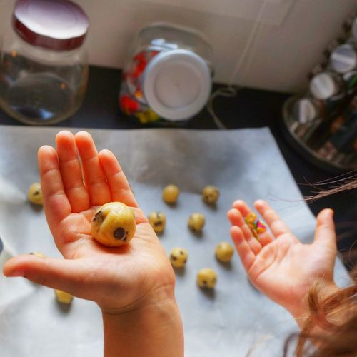 Cropped image of girl making cookies in kitchen
