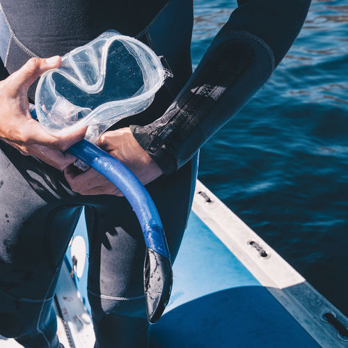 Adventure Close-up Diving Diving Gear Diving Goggles Holding Human Hand Leisure Activity Lifestyles Outdoors People Snorkel Snorkeling Water Wet Suit