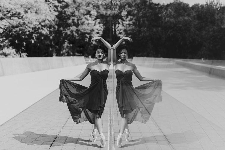 Ballet dancer standing by glass window