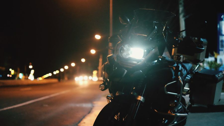 Motorcycle on road at night
