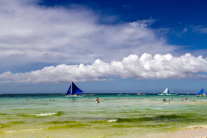 From Boracay island, Philippines. Sailing is a popular sport among locals and visitors. Fun Holiday Maritime Philippines Aklan Beach Boracay Cloud - Sky Clouds And Sky Horizon Over Water Island Nautical Vessel Ocean Outdoors Sail Sailing Sailship Sand Sea Ship Sky Sport Vacations Water White Beach First Eyeem Photo