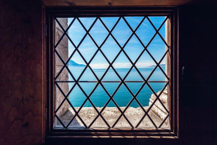 View of sea seen through window