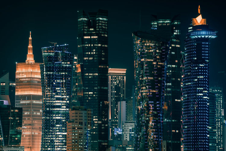 Doha, Qatar Building Exterior Built Structure Architecture City Building Night Illuminated Office Building Exterior Tall - High Modern Skyscraper Cityscape Tower Office Crowd Residential District Downtown District Financial District  Crowded Outdoors Spire  Doha Qatar Middle East