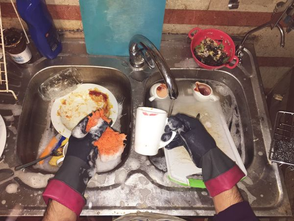 Dishwashing High Angle View Real People One Person Cooking Pan Human Hand Holding Food Day Camping Stove Human Body Part Indoors  Food Stories