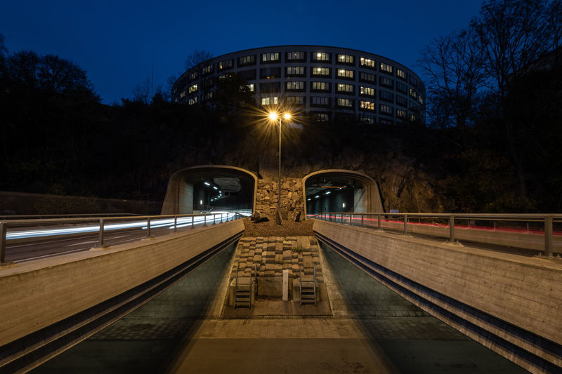 Illuminated Transportation Architecture Night Built Structure Direction Connection The Way Forward No People City Nature Sky Motion Bridge Long Exposure Outdoors Bridge - Man Made Structure Light Trail Diminishing Perspective Concrete Norra Länken Speeding Cars Traffic Tunnel Street Lamp