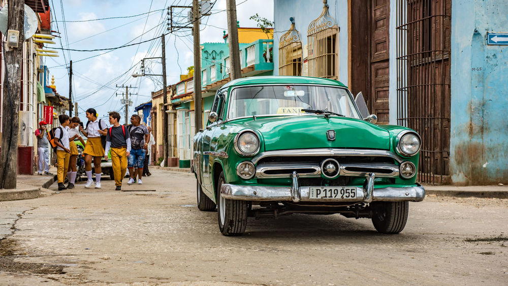 Most of the cars in Cuba are taxi's. In the morning the kids walk to school on Trinidad's dusty roads. Architecture Building Exterior Built_Structure Car Children City Classic Cuba Day EyeEm Best Shots Land Vehicle Mode Of Transport Old-fashioned Outdoors People Real People School School Uniforms Around The World Street Streetphotography Taxi The Street Photographer - 2017 EyeEm Awards Transportation Trinidad Live For The Story Let's Go. Together. Been There. An Eye For Travel Mobility In Mega Cities This Is Latin America Summer Road Tripping
